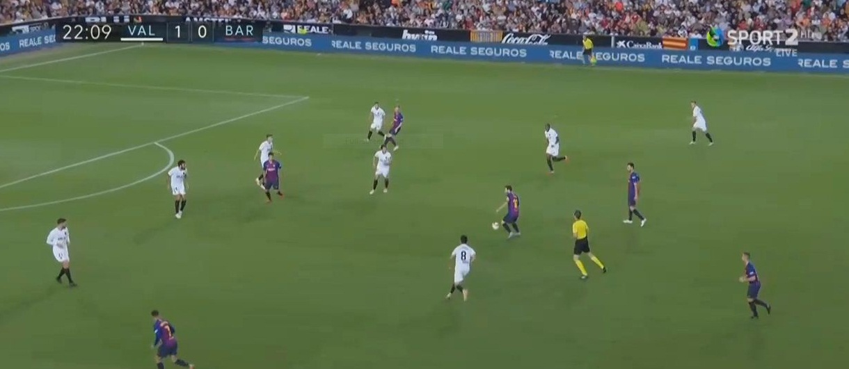 Build up to Barcelona's goal against Valencia. See Suarez holding the defender in place, essentially blocking him from following through to challenge Messi's shot